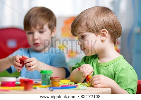 kids with play clay at home