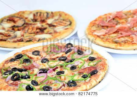 Three Different Kind Of Pizzas