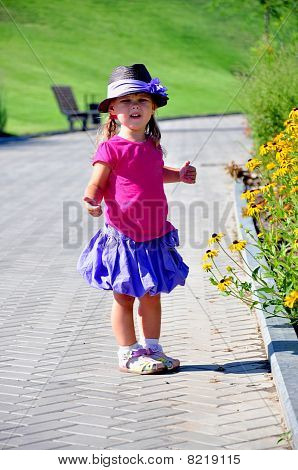 Little cute girl standing in the park
