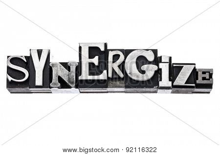 synergize - isolated word in vintage letterpress metal type blocks, variety of fonts