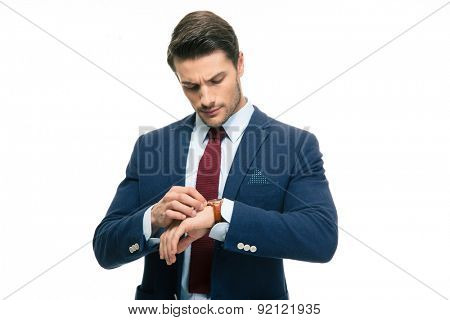 Handsome businessman looking on his wrist watch isolated on a white background