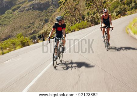Two Cyclist Practicing For Triathlon Race