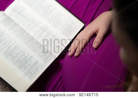 Expecting Mom Holding The Holy Bible