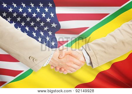 Businessmen shaking hands - United States and Congo-Brazzaville poster