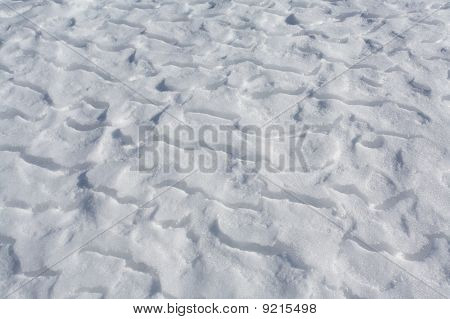 Snow Drifts On Frozen Lake