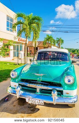 Green classic American car in Havana, Cuba