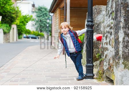Young boy with backpack ready to go back to school