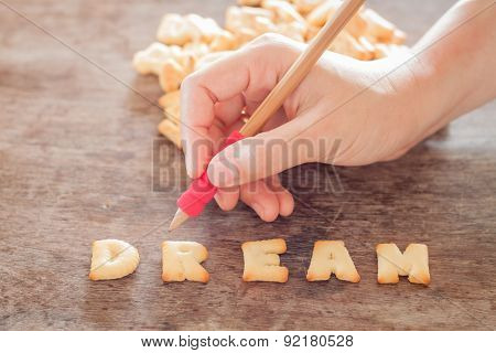 Dream Alphabet Biscuit On Wooden Table