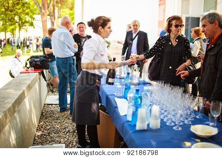 Waiter Pours A Drink