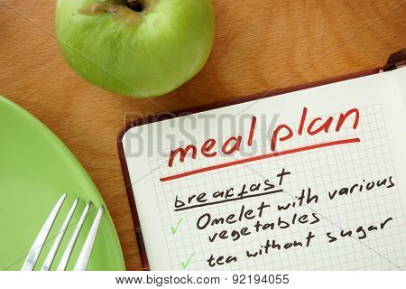 Notepad with words  meal plan with apple. Weight lose concept. poster