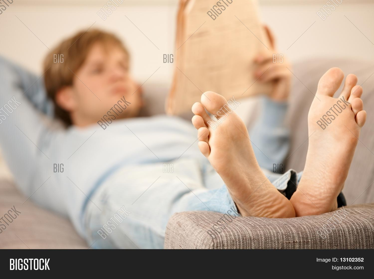 Man laying on his back on couch