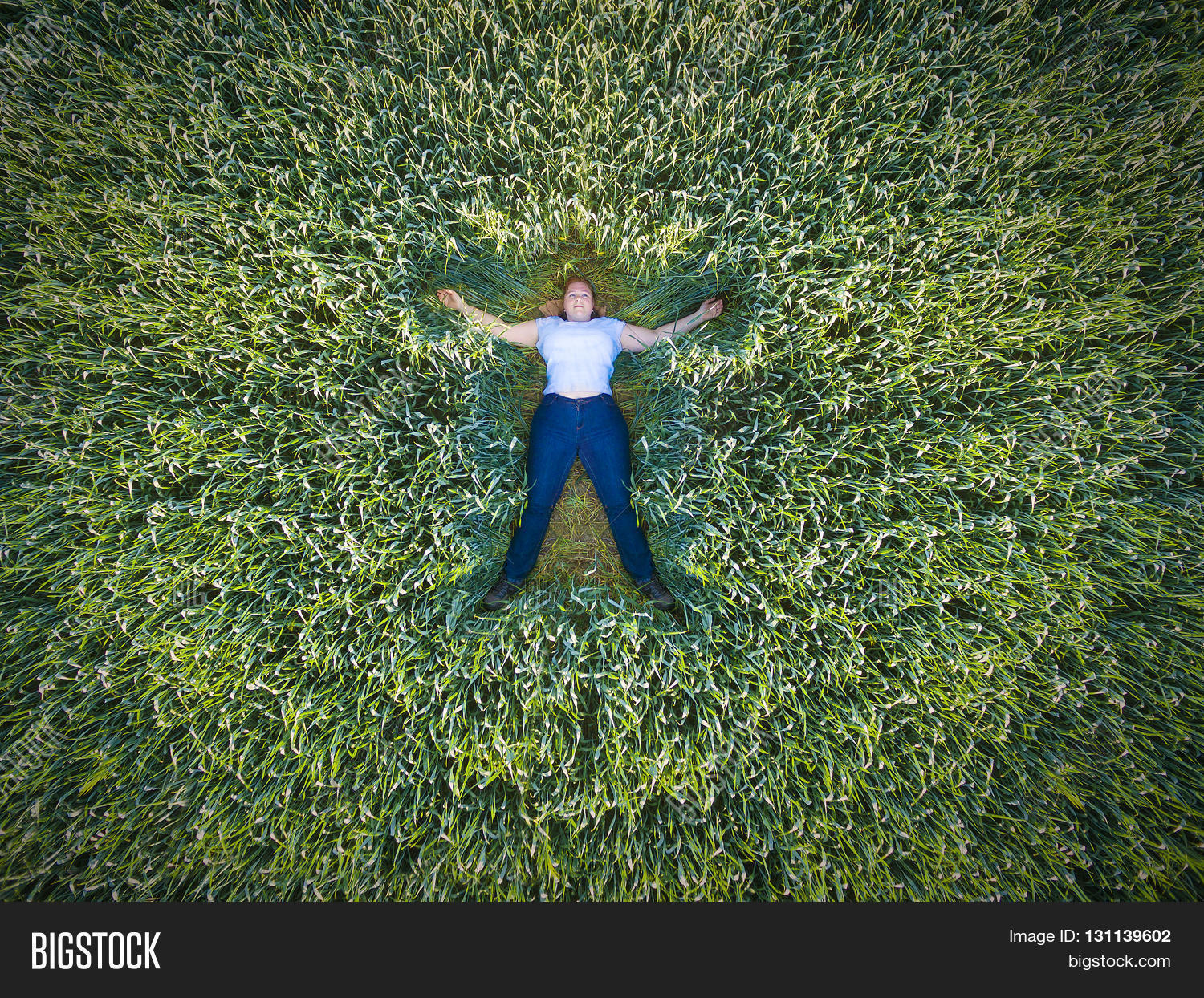 Aerial View Of Young Woman Meditating And Relaxing In Green Wheat Field Healthy Lifestyle Concept