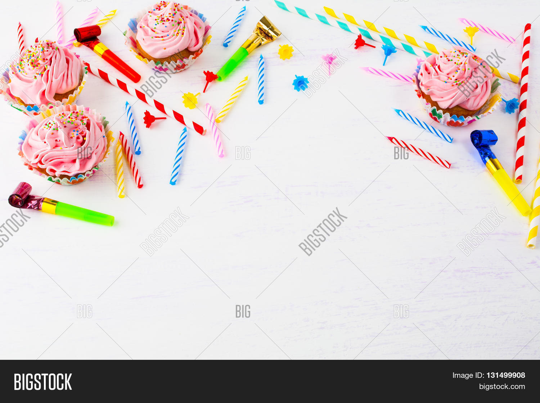 Birthday background pink cupcakes image photo bigstock birthday background with pink cupcakes and candles birthday cupcakes gourmet cupcakes sweet dessert stopboris Images