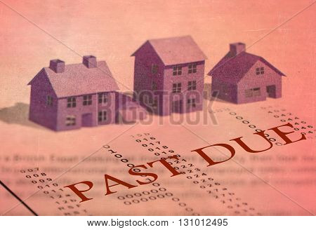 Past dues bills and mortgage foreclosure. Blurred house models background.