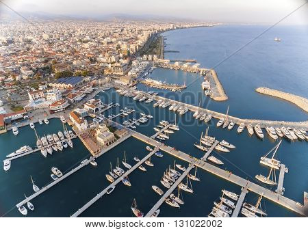 Aerial view of the beautiful Marina in Limassol city in Cyprus,beach,boats,piers,villas, commercial area,old port (palio limani) and Molos. A modern,high end,newly developed space with docked yachts.