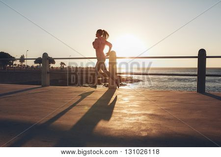 Young Woman Running On Seaside Promenade