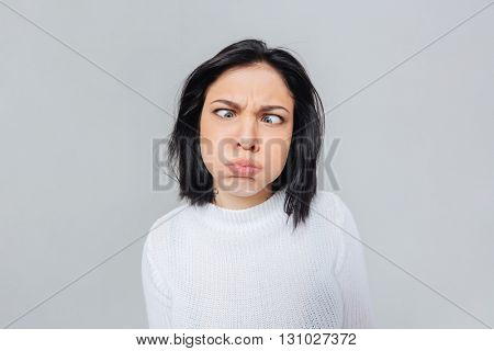 Woman making funny crazy face, isolated on white background