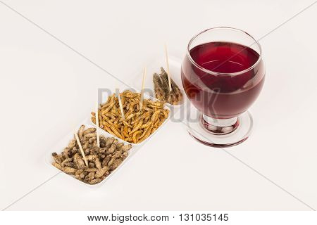 Fried crickets locust molitor insects with glass of wine, food of future rich protein France