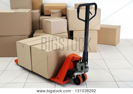 Manual pallet truck with carton boxes indoors