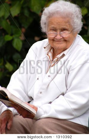 Elderly Lady Outside Reading