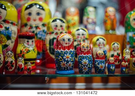 Matryoshka dolls. Plenty of hand-painted Russian dolls displayed in the shop. Close up view.