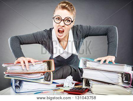 Upset Secretary At Her Desk.