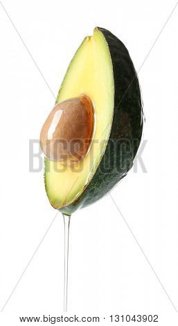 Fresh avocado with oil isolated on white