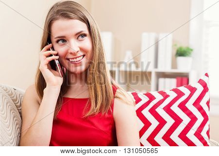 Happy Young Woman Talking On Her