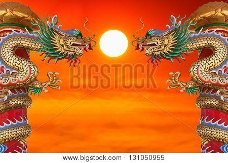 Chinese style dragon statue at beautiful sunset