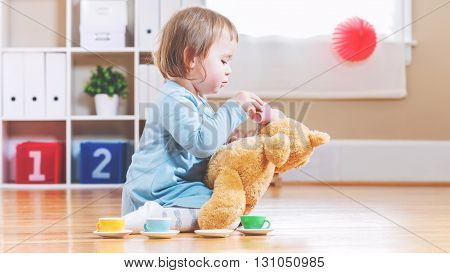 Toddler Girl Have Tea With Her Teddy Bear