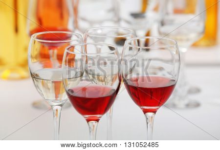 Wine glasses with red and white wine, closeup