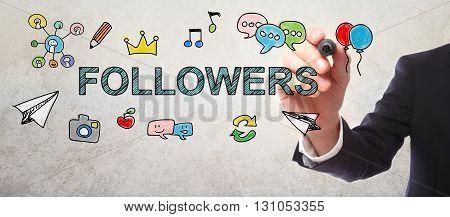 Businessman Drawing Followers Concept