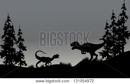 Silhouette of two allosaurus in hills with gray backgrounds
