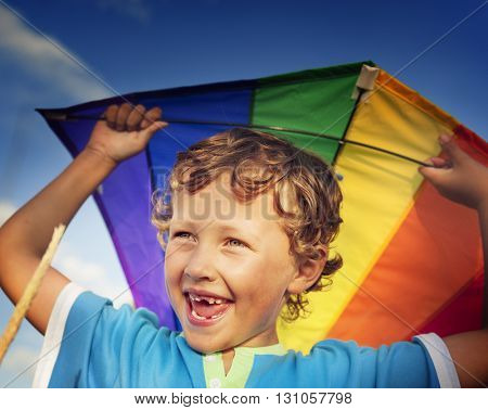 Boy Flying Kite Happiness Smiling Playing Playful Concept