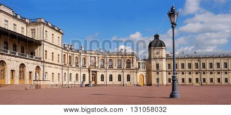 Gatchina Palace. Palace Square and the main entrance. Palace Square and the main entrance. Central building with balconies, street light and side tower.