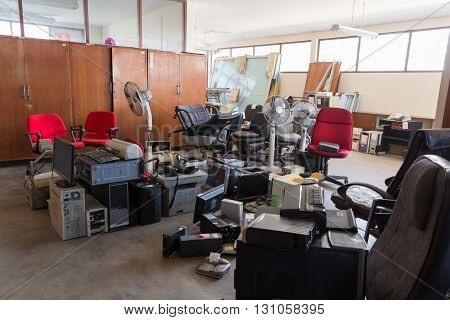 Abandoned office equipments, office supplie in a warehouse