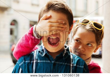 child covers his eyes with his brother