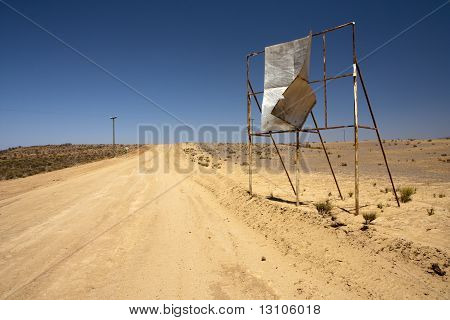 Broken Billboard In Desert