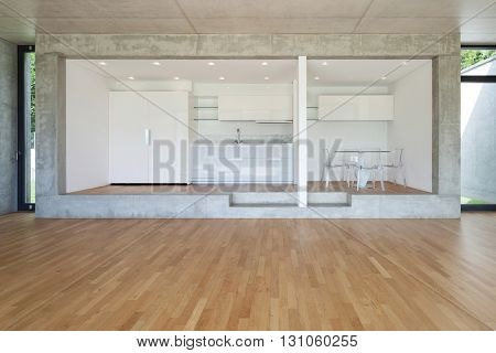 Interior, modern kitchen of concrete apartment, parquet floor