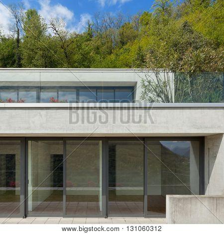 Exterior, facade of a modern house, woodland background