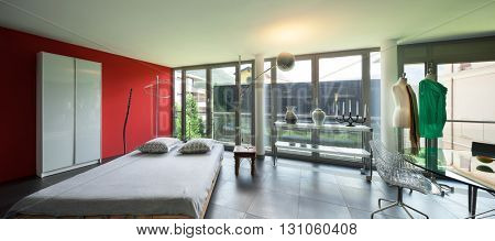 Interior of a studio apartment, wide room with glass table and bed