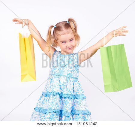 Shopping Child. Little Girl Holding Shopping Bags
