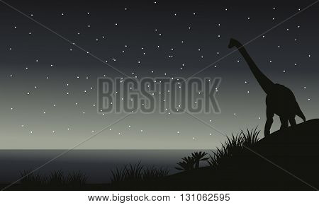 Silhouette of brachiosaurus at night with gray backgrounds