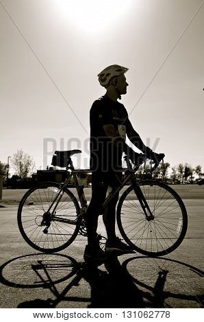 FARGO, NORTH DAKOTA-May 15, 2016: The Cyclothon Bike Run is ready to start at the annual Fargo Marathon where a biker is silhouetted against the sky, 5K, 10K,half and full runs.