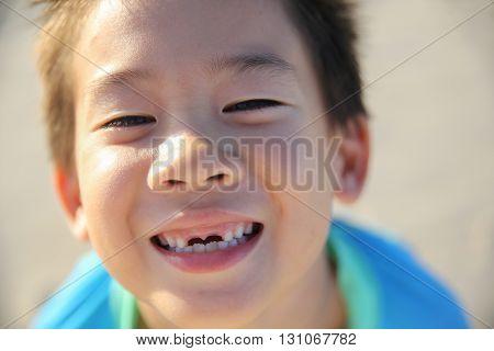 caucasian boy losing front teeth happy smile