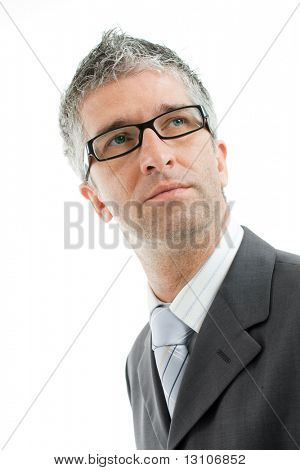 Closeup portrait of serious businessman wearing gray suit and tie, glasses. Isolated on white background.