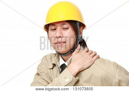 Japanese construction worker suffers from neck ache