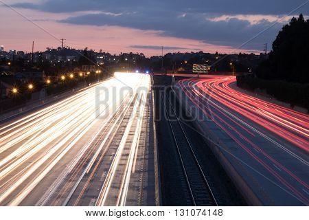 Long Exposure over 10 Freeway at dusk with cars passing underneath in both directions
