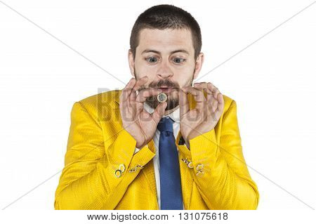 Businessman With Big Eyes Looking At His Coin