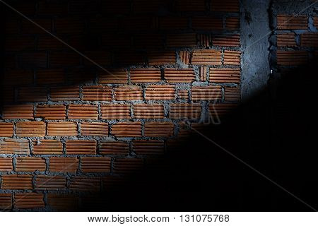 Brick Wall In Residential Construction Site With Light Sunshine Through The Window